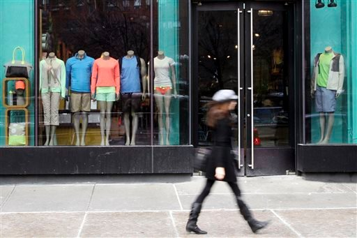 FILE - In this Tuesday, March 19, 2013 file photo, a woman walks past the Lululemon Athletica store at Union Square in New York. (AP)