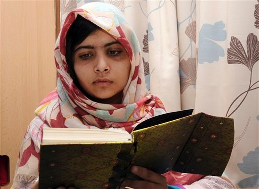 FILE - In this undated file photo provided by Queen Elizabeth Hospital in Birmingham, England, Malala Yousufzai, the 15-year-old girl who was shot at close range in the head by a Taliban gunman in Pakistan, reads a book during her recovery. (AP)