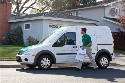This undated photo provided by Google shows a Google Shopping express van. Internet search leader Google is taking another step beyond information retrieval into grocery delivery.