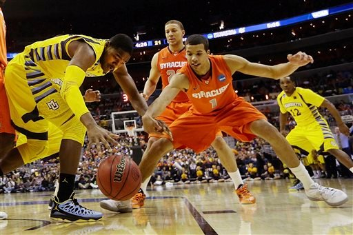 Marquette forward Steve Taylor Jr., (25) and Syracuse guard Michael Carter-Williams (1) reach for a loose ball during the first half of the East Regional final in the NCAA men's college basketball tournament, Saturday, March 30, 2013, in Washington.