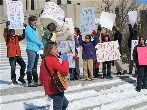 In this March 25, 2013 file photo, Kris Kitko leads chants of protest at an abortion-rights rally at the state Capitol in Bismarck, N.D.