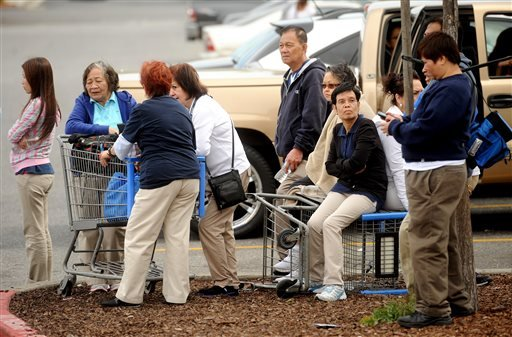 Walmart workers gather outside a Walmart in San Jose, Calif., after a motorist drove through a store entrance and began assaulting shoppers on Sunday, March 31, 2013. Four people sustained injuries during the attack according to a police spokesman.