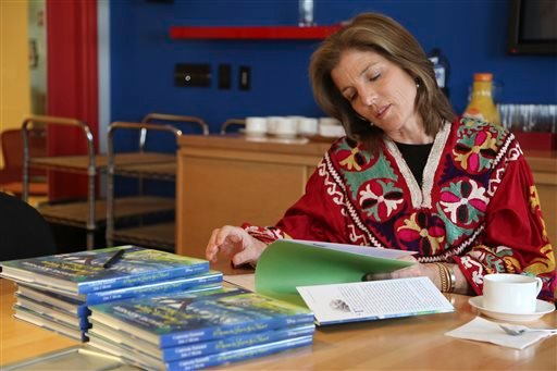 """In this Tuesday, March 26, 2013 photo, Caroline Kennedy flips through her new book """"Poems to Learn by Heart"""" during an interview with The Associated Press in New York. Kennedy's 10th and latest book extols the value of learning poems by heart."""