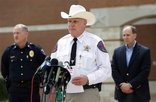 Kaufman County Sheriff David Byrnes, center, speaks at a news conference, Sunday, March 31, 2013, in Kaufman, Texas.