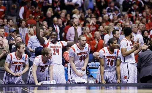 Louisville players react on the bench react in the final minutes of the second half of the Midwest Regional final against Duke in the NCAA college basketball tournament, Sunday, March 31, 2013, in Indianapolis. (AP)