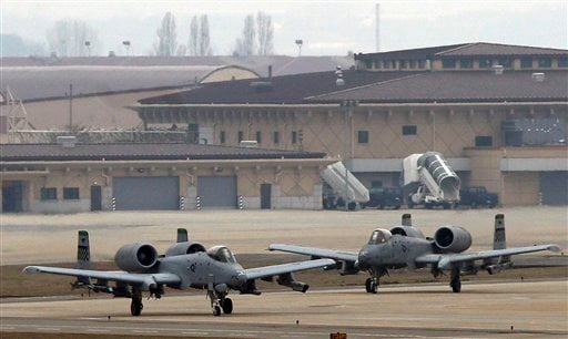 U.S. Air Force A-10 attack aircraft wait to take off on the runway during their military exercise at the Osan U.S. Air Base in Pyeongtaek, south of Seoul, South Korea, Tuesday, April 2, 2013.