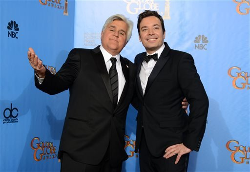 "Jan. 13, 2013 file photo: Jay Leno, host of ""The Tonight Show with Jay Leno"" and Jimmy Fallon, host of ""Late Night with Jimmy Fallon"" backstage at the 70th Annual Golden Globe Awards in Beverly Hills, Calif. (Photo by Jordan Strauss/Invision/AP, file)"