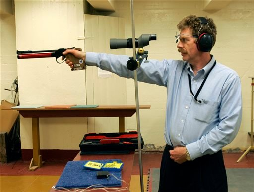 FILE--In this Feb. 21, 2007 file photo, Bruce Martindale takes aim as he competes in a weekly air gun league in Troy, N.Y. Martindale, who normally uses a .22-caliber, has cut back on practice because ammunition is in short supply. (AP Photo/Mike Groll)