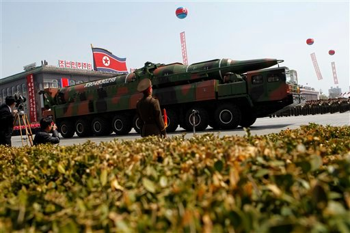 FILE - In this Sunday, April 15, 2012 file photo, a North Korean vehicle carrying what appears to be a new missile passes by during a mass military parade in Pyongyang's Kim Il Sung Square. (AP)