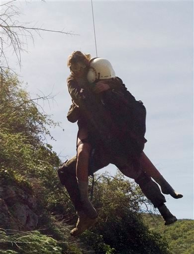 This photo provided by Los Angeles County Search and Rescue Reserve Deputy Doug Cramoline shows the helicopter rescue of Kyndall Jack, 18, by an L.A.