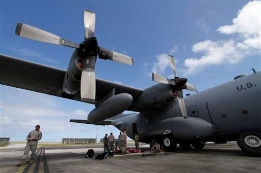 In this Feb. 7, 2013 file photo, members of the 374th Airlift Wing of U.S. Air Force work on a C-130 aircraft during the Cope North military exercises at Andersen U.S. Air Force Base in Guam.