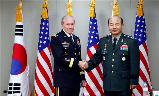 In this Thursday, Oct. 27, 2011 file photo, South Korean Joint Chiefs of Staff Chairman Gen. Jung Seung-jo, right, shakes hands with his U.S. counterpart, Gen. Martin Dempsey before their Military Committee Meeting between the U.S. and South Korea.