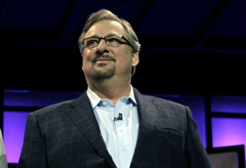 In this Nov. 29, 2010, file photo, Pastor Rick Warren acknowledges audience members during the Saddleback Civil Forum on Leadership and Service in Lake Forest, Calif.