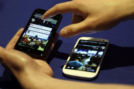 Cell phones with the a new Facebook interface are displayed at the company's headquarters in Menlo Park, Calif., Thursday, April 4, 2013. (AP Photo/Marcio Jose Sanchez)