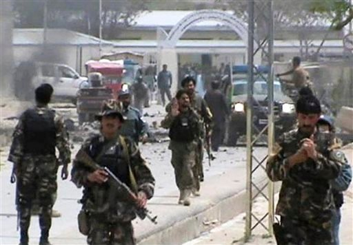 This image made from AP video shows Afghan National Army soldiers rushing to the scene moments after a car bomb exploded in front the PRT, Provincial Reconstruction Team, in Qalat, Zabul province, southern Afghanistan, Saturday, April 6, 2013.