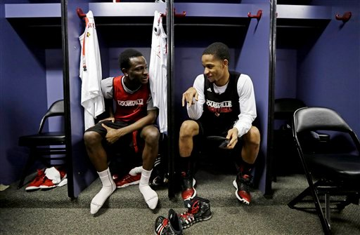 Louisville's Michael Baffour, left, and Jordan Bond chat in the locker room before practice for their NCAA Final Four tournament college basketball game Sunday, April 7, 2013, in Atlanta.