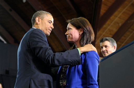 President Barack Obama looks at Nicole Hockley and her husband Ian, right, after she introduced him at the University of Hartford in Hartford, Conn., Monday, April 8, 2013.  (AP)
