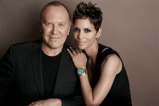 In this April 6, 2013 photo provided by Michael Kors, Kors and actress Halle Berry pose for a photo at Kors' Midtown office in New York.