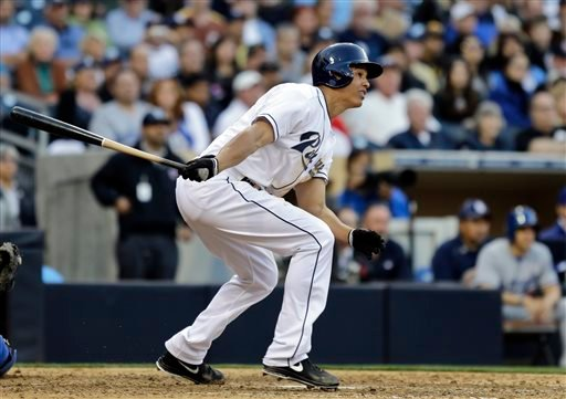 San Diego Padres' Will Venable watches the flight of his bases-loaded triple against the Los Angeles Dodgers during the eighth inning of a baseball game in San Diego, Tuesday, April 9, 2013. (AP Photo/Lenny Ignelzi)