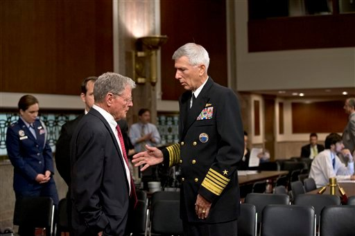 Sen. James Inhofe, R-Okla., the ranking Republican on the Senate Armed Services Committee, left, confers with Adm. Samuel Locklear, commander of U.S. Pacific Command, on Capitol Hill in Washington, Tuesday, April 9, 2014.