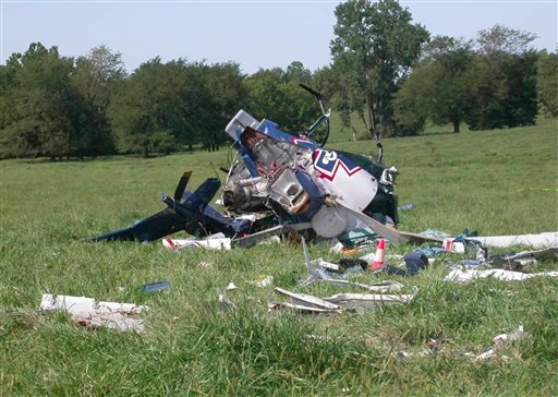 This photo provided by the National Transportation Safety Board, shows the wreckage of a helicopter that crashed near Mosby, Mo., on Aug. 26, 2011.
