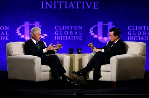 This April 6, 2013 file photo shows former President Bill Clinton, left, and Comedy Central's Stephen Colbert during the Clinton Global Initiative at Washington University in St. Louis.