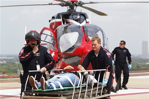 Life Flight personnel rush a victim wounded in a stabbing attack on the Lone Star community college system's Cypress, Texas campus into Memorial Hermann Hospital Tuesday, April 9, 2013, in Houston. (AP)