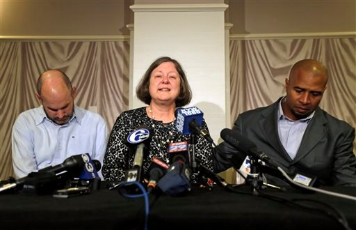 ormer NFL player Dorsey Levens, right, extends a hand as Mary Ann Easterling, the widow of former NFL player Ray Easterling, reacts as former NFL player Kevin Turner, left, looks on during a news conference, Tuesday, April 9, 2013, in Philadelphia.(AP)