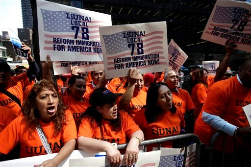 Participants shout at a rally outside the office of Sen. Chuck Schumer, D-N.Y., in New York, Wednesday, April 10, 2013. Over one hundred people gathered to express their support for immigration reform and to thank Schumer for his leadership on the issue.