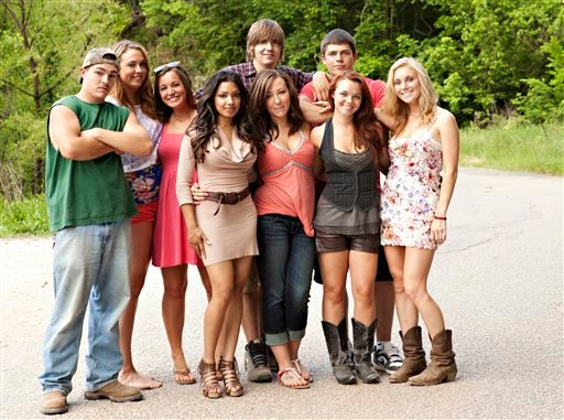 "FILE - This undated image originally released by MTV shows the cast of the new reality series ""Buckwild,"" from left, Shain Gandee, Anna, Katie, Salwa, Joey, background center, Ashley, Tyler, background right, Cara and Shae. (AP)"