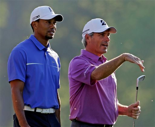 Fred Couples, right walks with Tiger Woods off the 12th tee during a practice round for the Masters golf tournament Wednesday, April 10, 2013, in Augusta, Ga. (AP Photo/Darron Cummings)