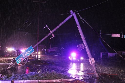 The street light at Howdershell Road and Lynn Haven Lane lies damaged following high winds from a strong spring storm in Hazelwood late Wednesday evening, April 10, 2013. (AP Photo/Erik M. Lunsford, Post-Dispatch)