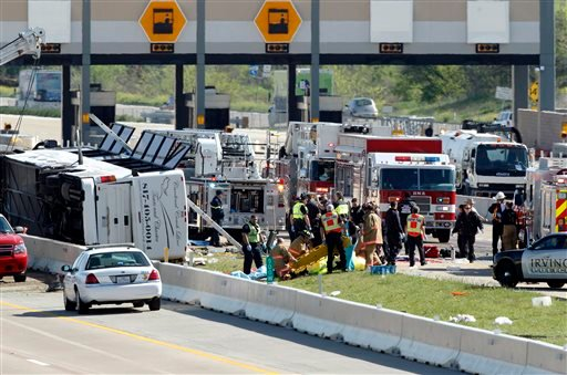 First responders are on the scene of a Cardinal Coach Line charter bus accident on Hwy. 161 in Irving, Texas on Thursday morning, April 11, 2013.  (AP Photo/The Dallas Morning News, Tom Fox)