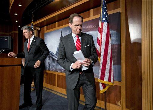 Sen. Pat Toomey, R-Pa., right, and Sen. Joe Manchin, D-W.Va., finish a news conference on Capitol Hill in Washington, Wednesday, April 10, 2013. (AP)