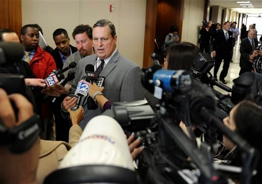 Jules Laird, center, defense attorney for Dylan Quick, talks to the media Thursday, April 11, 2013, in Houston. Quick, alleged to have wounded more than a dozen people at a Houston area Lone Star College campus.
