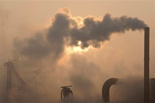 Smoke is emitted from chimneys of a cement plant in Binzhou city, in eastern China's Shandong province on Thursday, Jan. 17, 2013.