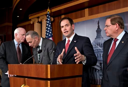 In this Jan. 28, 2013, file photo Sen. Marco Rubio, R-Fla., center, speaks at a Capitol Hill news conference on immigration legislation with a members of a bipartisan group of leading senators.