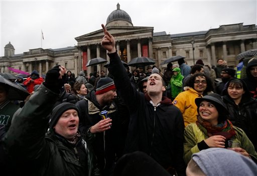 People sing and dance during a party to mark the death of former British Prime Minister Margaret Thatcher, in central London's Trafalgar square, Saturday, April 13, 2013.