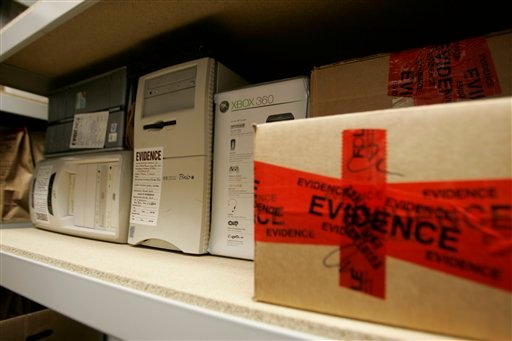 In this Nov. 8, 2006, file photo, confiscated computers and child-oriented pornographic tapes fill the storeroom shelves in the Florida Attorney General's Child Predator CyberCrime Unit office in Jacksonville, Fla.