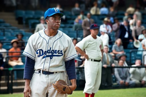 "This film image released by Warner Bros. Pictures shows Chadwick Boseman as Jackie Robinson in a scene from ""42,"" by writer-director Brian Helgeland."