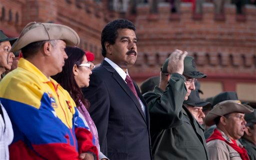 Venezuela's interim President Nicolas Maduro attends a ceremony marking the Day of the National Revolutionary Militia, also called Bolivarian militias, in Caracas, Venezuela, Saturday, April 13, 2013.