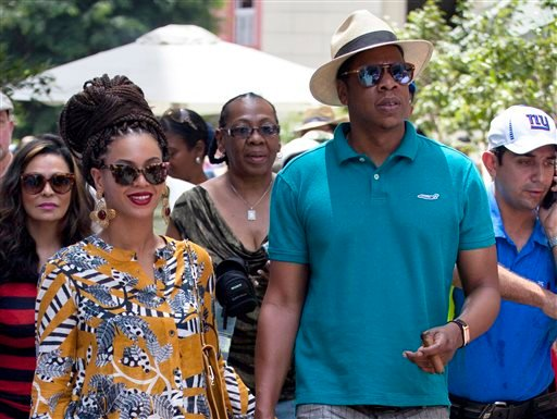 This April 4, 2013 file photo shows married musicians Beyonce, left, and rapper Jay-Z as they tour Old Havana, Cuba.