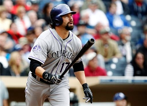 Colorado Rockies' Todd Helton watches his pinch-hit, two-run home run against the San Diego Padres in the seventh inning during a baseball game, Sunday, April 14, 2013, in San Diego. (AP Photo/Alex Gallardo)