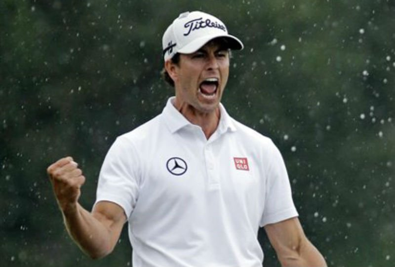 Adam Scott, of Australia, celebrates after a birdie putt on the 18th green during the fourth round of the Masters golf tournament Sunday, April 14, 2013, in Augusta, Ga. (AP Photo/Matt Slocum)