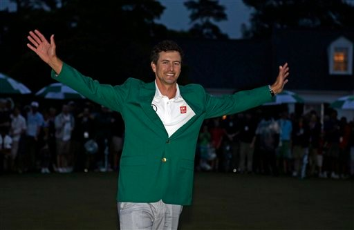 Adam Scott, of Australia, poses with his green jacket after winning the Masters golf tournament Sunday, April 14, 2013, in Augusta, Ga. (AP Photo/Darron Cummings)