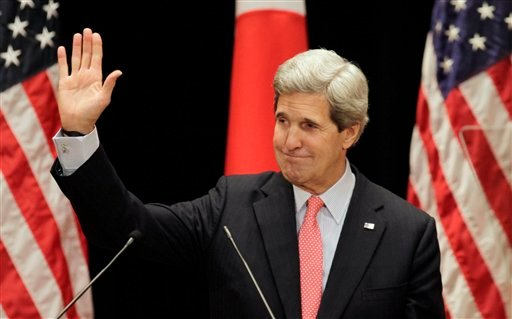 U.S. Secretary of State John Kerry waves after his lecture to students at Tokyo Institute of Technology in Tokyo Monday, April 15, 2013. Kerry is here as part of Asian tour amid a tense situation over a possible missile launch by North Korea.