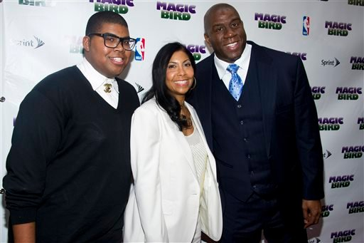 """This April 11, 2012 file photo shows Magic Johnson, right, his wife Cookie and son E.J. arriving for the opening night performance of the Broadway play """"Magic/Bird"""" in New York."""