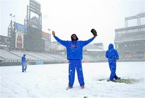New York Mets pitcher LaTroy Hawkins poses in the snow before a scheduled baseball game against the Colorado Rockies, Monday, April 15, 2013, in Denver. The game has been canceled. (AP Photo/Jack Dempsey)