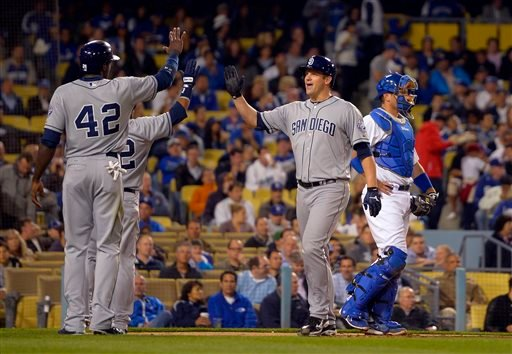 San Diego Padres' Eric Stults, second from right, is congratulated by Cameron Maybin, left, and Alexi Amarista, second from left, after hitting a three-run home run as Los Angeles Dodgers.