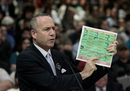 State Senate President Pro Tem Darrell Steinberg, D-Sacramento, displays a newspaper ad showing the type of assault style rifle that his proposed legislation would ban in California during a hearing of the Senate Public Safety Committee in Sacramento.(AP)